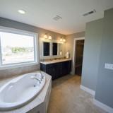 Custom master bathroom by Design Homes.