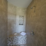 Custom master shower by Design Homes.