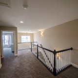 Custom hall way by Design Homes.