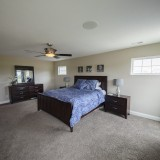 Custom master bed by Design Homes.