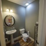 Custom powder room by Design Homes.