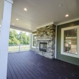 Custom Porch in Country Brook by Design Homes