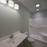 Custom bathroom in lower level by Design Homes.