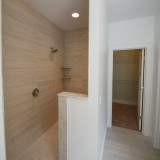 Custom walk-in, tile shower by Design Homes.