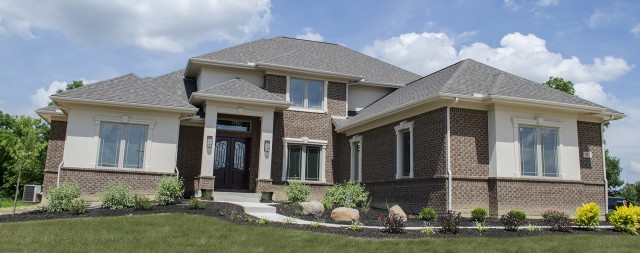 Custom feature exterior in Winding Creek by Design Homes.