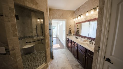 Master bathroom with tile shower by custom home builder, Design Homes and Development.