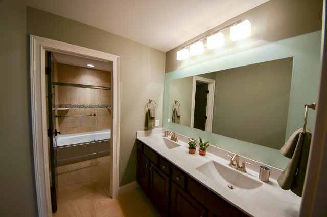 Custom bathroom in The Aria, with etched mirror. The Homearama home by Design Homes.