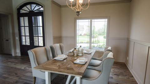 Custom dining room by Design Homes, home builder.