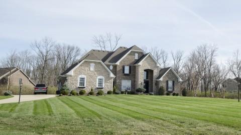 Custom exterior in Cypress Ridge, by Design Homes.