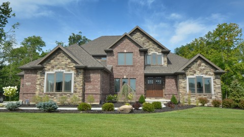 Custom exterior in the Villages of Winding Creek by Design Homes.