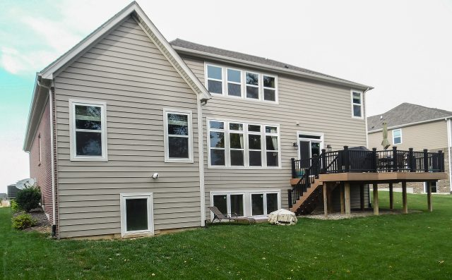 Custom exterior in Yearling Farms. Built by Design Homes and Development.