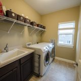 Custom laundry room in Yearling Farms. Built by Design Homes and Development.