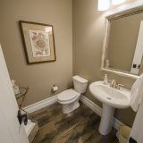 Custom bathroom of The Mitchell in Soraya Farms. A custom model home by Design Homes & Development.