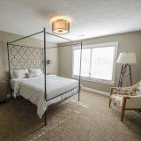 Custom bedroom of The Mitchell in Soraya Farms. A custom model home by Design Homes & Development.