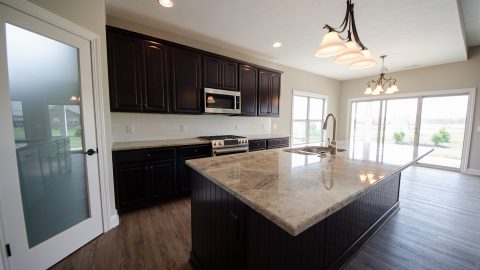 Custom kitchen in the Beach residence in Soraya Farms. Built by Design Homes & Development.