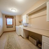 Laundry room of Hayden residence. Listed by Design Homes & Development.