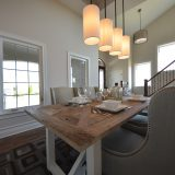 Custom dining room of The Mitchell in Soraya Farms. A custom model home by Design Homes & Development.