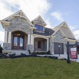 Custom exterior of The Mitchell in Soraya Farms. A custom model home by Design Homes & Development.