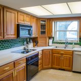 Kitchen of Hancock residence. Listed by Design Homes & Development.