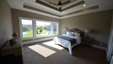 Custom, master bedroom in The Mitchell. Built by Design Homes & Development.