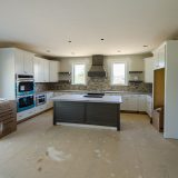Custom kitchen of the Triple Crown in Bridle Creek Ranch. By Design Homes & Development.