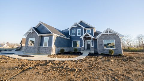 Custom exterior of The Triple Crown. A home located in Cypress Ridge by Design Homes and Development.