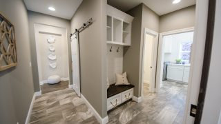 Custom Mud Hall in the Oakwood plan by Design Homes