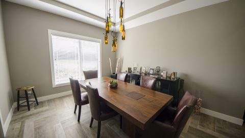 Custom dining room in Villages of Winding Creek. Built by Design Homes and Development.