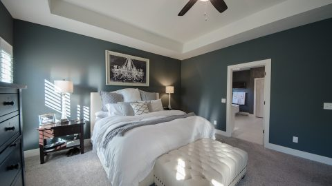 Custom master bedroom by Design Homes and Development.