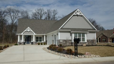 Custom exterior of a standard Mitchell plan. Built by Design Homes & Development.
