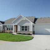 Custom exterior of The Abbington. A maintenance free home by Design Homes and Development.