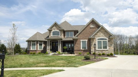 Custom Saddle Creek exterior by Design Homes Development.