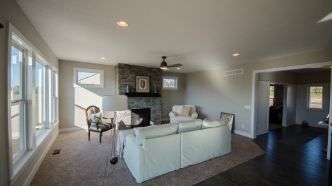Custom great room by Design Homes and Development