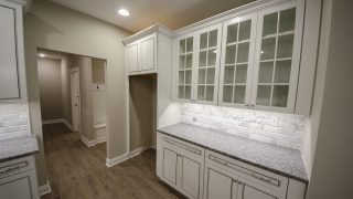 Custom Kitchen Storage by Design Homes