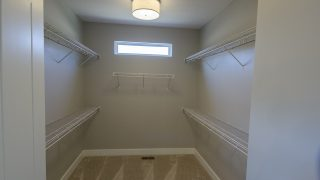 Master Closet of the Jocelyn in Soraya Farms by Design Homes