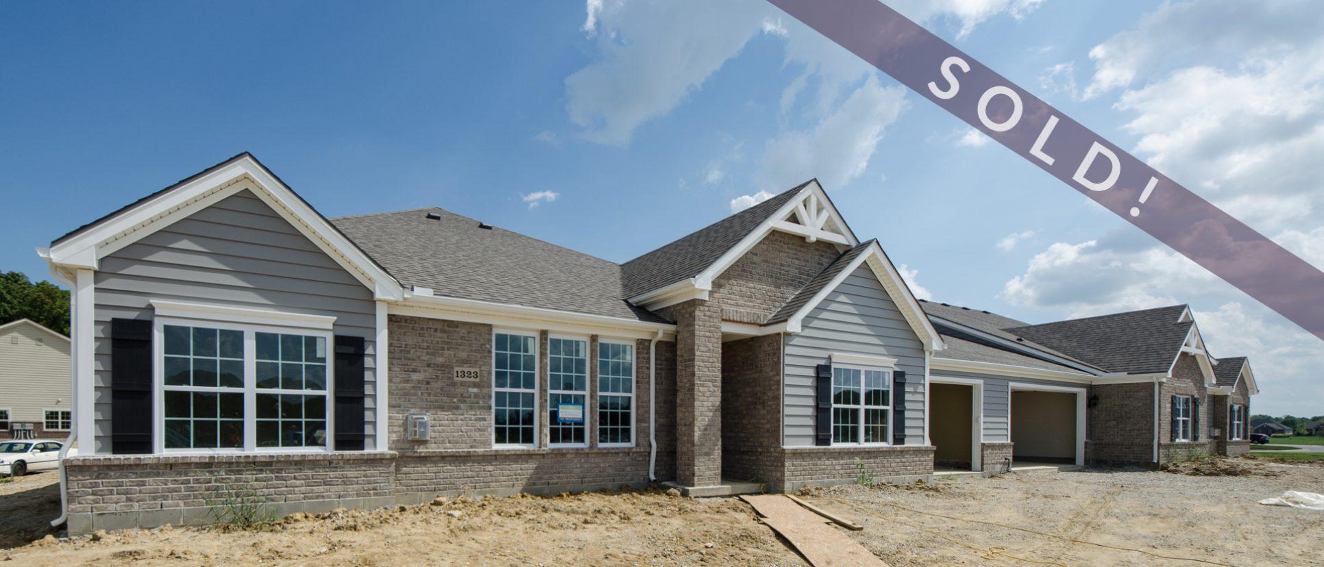 Custom exterior of The Abbington. A multi-family unit by Design Homes and Development.