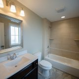 Custom bathroom of The Amber. A custom home by Design Homes & Development, located in Cypress Ridge.