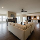 Custom great room of The Amber. A custom home by Design Homes & Development, located in Cypress Ridge.