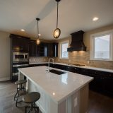 Custom kitchen of The Amber. A custom home by Design Homes & Development, located in Cypress Ridge.