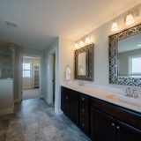 Custom master bathroom of The Amber. A custom home by Design Homes & Development, located in Cypress Ridge.