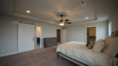 Custom master bedroom in The Amber. Built by Design Homes & Development.