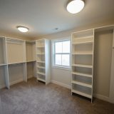 Custom Master Closet in the Amber plan by Design Homes