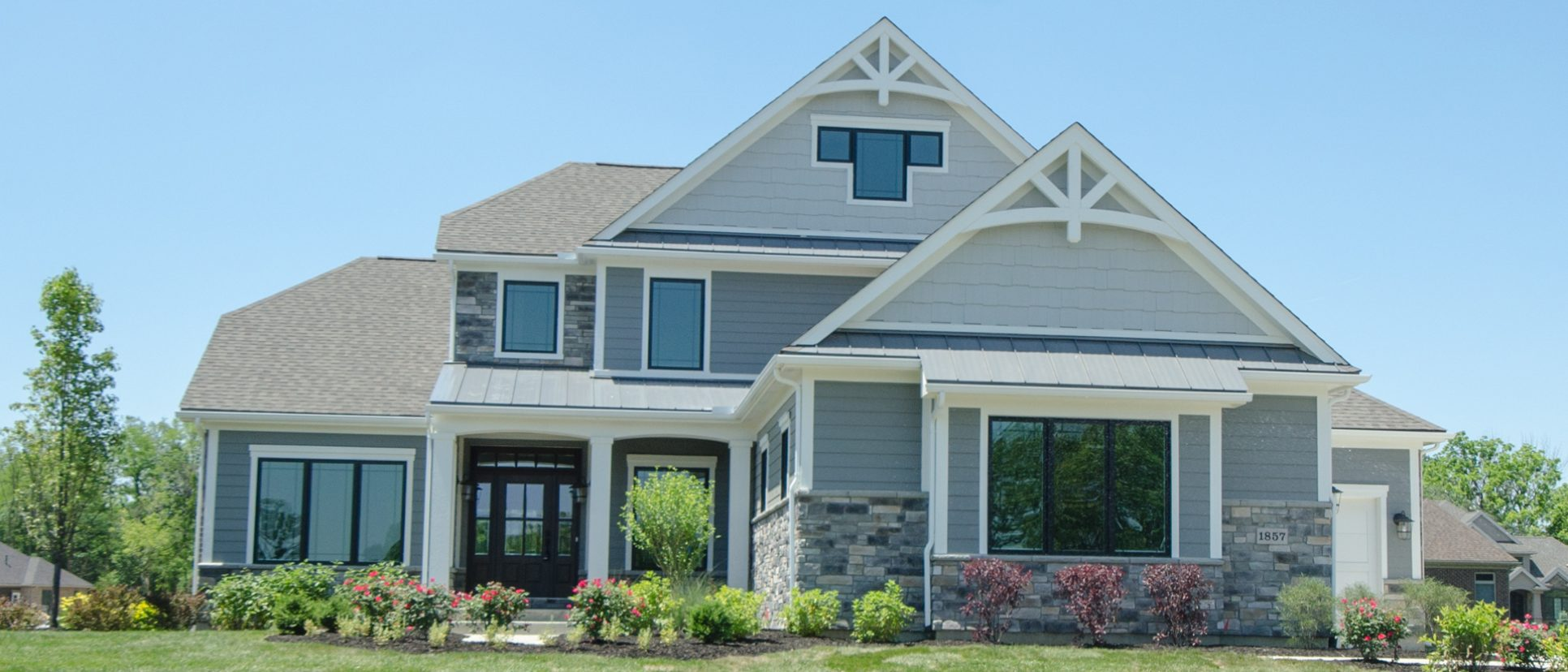 Custom exterior of The Arianna. Built by Design Homes and Development.