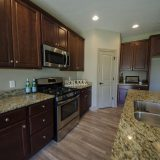 Kitchen in a custom Chianti by Design Homes and Development.