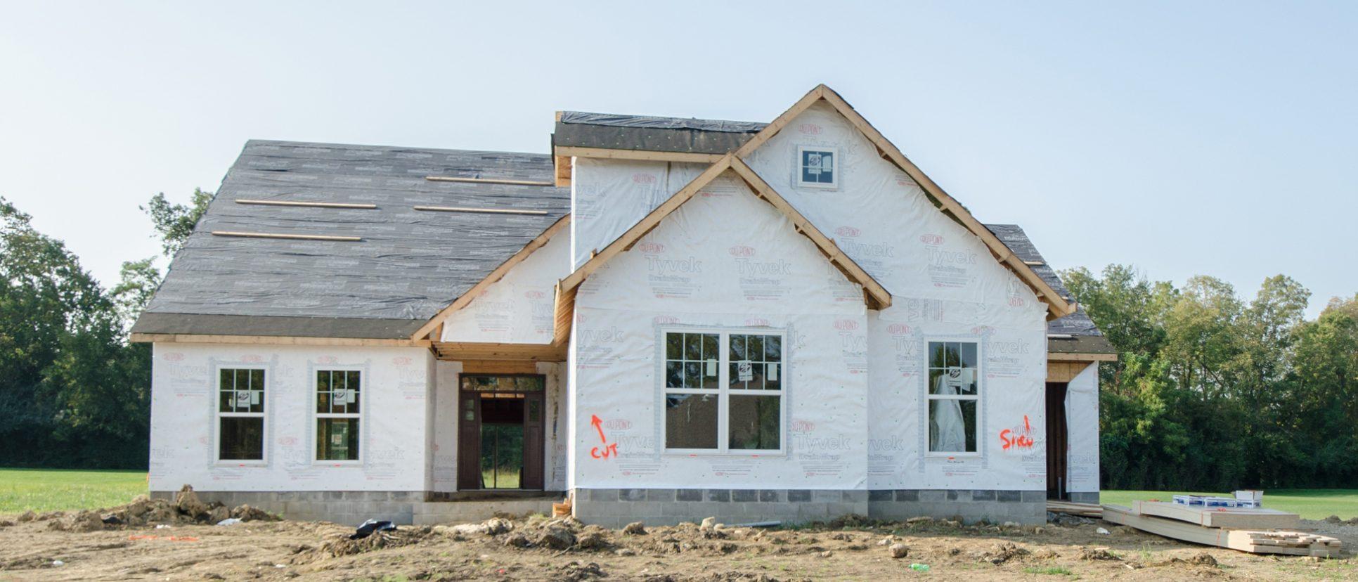 Custom exterior of The Jocelyn, under construction. Built by Design Homes.