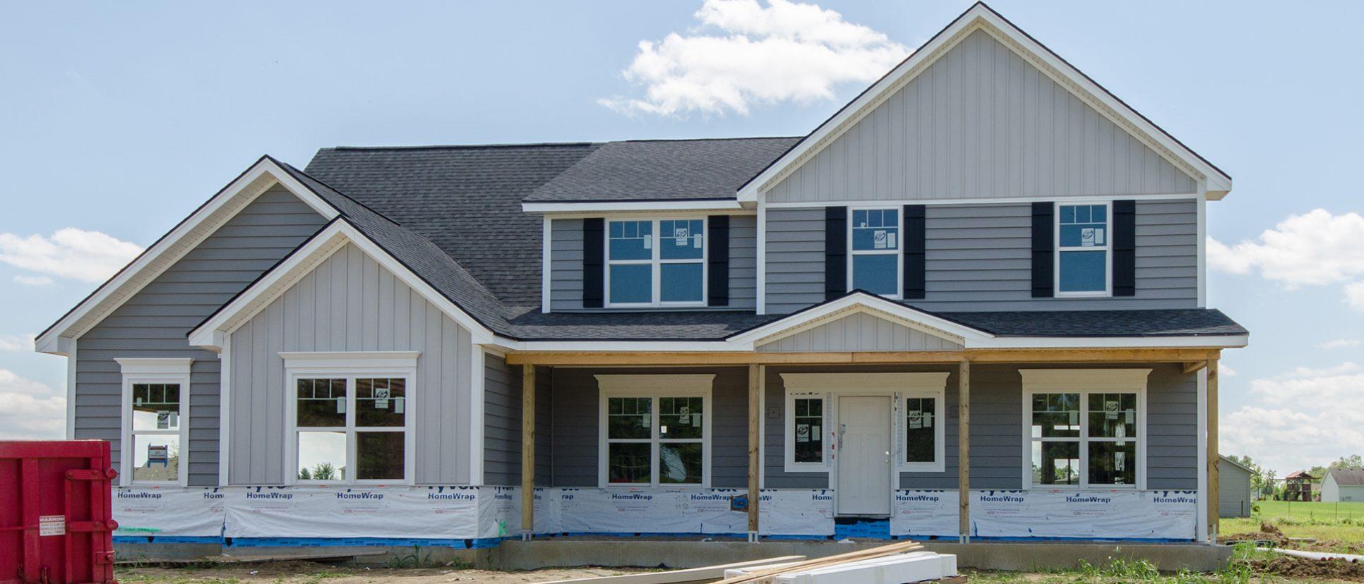 Custom exterior of The Lexington. By Design Homes & Development.