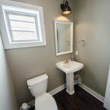 Custom powder room in The Shiloh by Design Homes & Development.