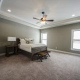 Custom bedroom in The Shiloh by Design Homes & Development.
