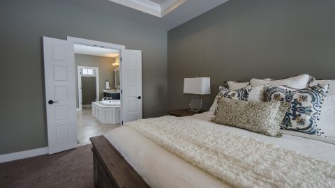 Custom bedroom by Design Homes and Development. Built by Design Homes & Development.