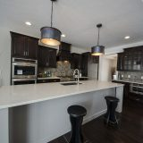 Custom kitchen in The Shiloh by Design Homes & Development.